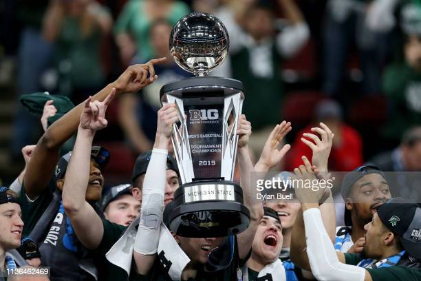 The Michigan State Spartans celebrate after beating the Michigan Wolverines 6560 in the championship game of the Big Ten Basketball Tournament at the...