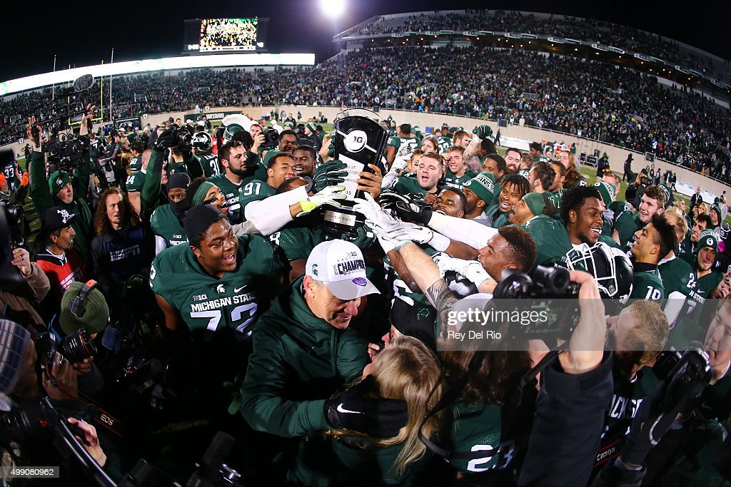 The Michigan State Spartans celebrate after the game against the Penn State Nittany Lions at Spartan Stadium on November 28, 2015 in East Lansing, Michigan. Michigan State defeated Penn State 55-16 to clinch a berth in the Big Ten championship game.