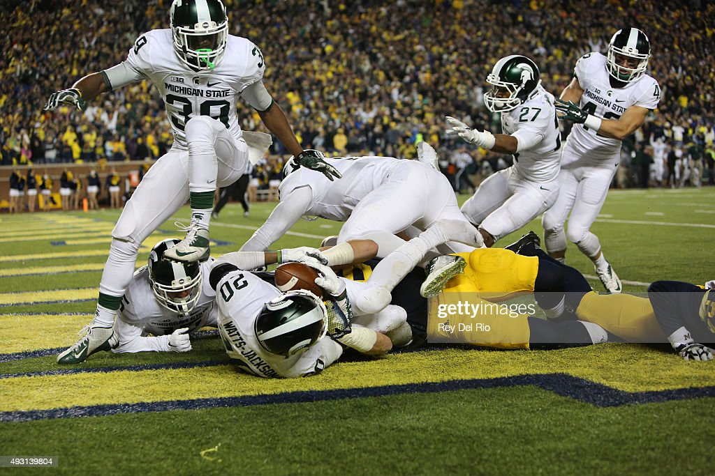 The Michigan State Spartans celebrate in the endzone after defensive back Jalen Watts-Jackson #20 scored the game winning touchdown against the Michigan Wolverines during the final seconds of college football game at at Michigan Stadium on October 17, 2015 in East Lansing, Michigan.