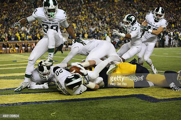 The Michigan State Spartans celebrate in the endzone after defensive back Jalen WattsJackson scored the game winning touchdown against the Michigan...