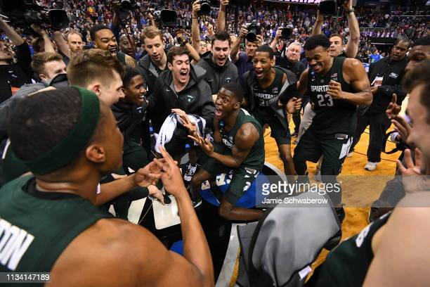 The Michigan State Spartans celebrate their victory over the Duke Blue Devils in the Elite Eight round of the 2019 NCAA Photos via Getty Images Men's...