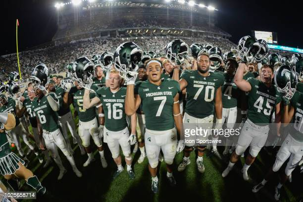 The Michigan State Spartans celebrate victory following a nonconference college football game between Michigan State and Utah State on August 31 at...