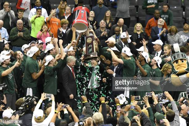 The Michigan State Spartans celebrate winning the East Regional game of the 2019 NCAA Men's Basketball Tournament against the Duke Blue Devils at...