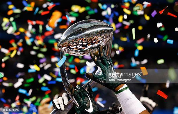 The Michigan State Spartans celebrate with the game trophy after beating the Baylor Bears 42-41 during the Goodyear Cotton Bowl Classic at AT&T...