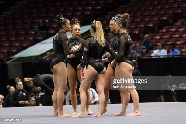 The Michigan State Spartans floor gymnasts huddle during the Elevate the Stage Meet on March 8 2019 at Legacy Arena in Birmingham Alabama