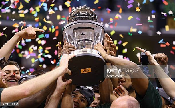 The Michigan State Spartans hold the winner's trophy after the 6955 win over the Michigan Wolverines during the finals of the Big Ten Basketball...