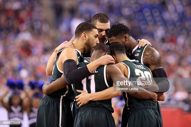 The Michigan State Spartans huddle at the start of the game against the Duke Blue Devils during the NCAA Men's Final Four Semifinal at Lucas Oil...