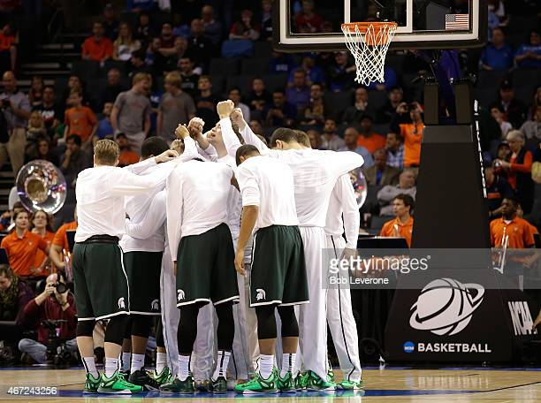The Michigan State Spartans huddle before the start of their game against the Virginia Cavaliers during the third round of the 2015 NCAA Men's...