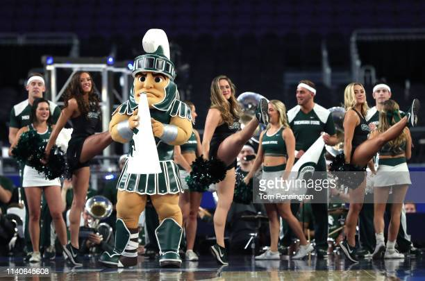 The Michigan State Spartans mascot and cheerleaders perform during practice prior to the 2019 NCAA men's Final Four at US Bank Stadium on April 5...