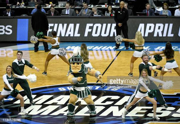 The Michigan State Spartans mascot performs with the cheerleaders on March 31 at the Capital One Arena in Washington DC during the Division I Men's...