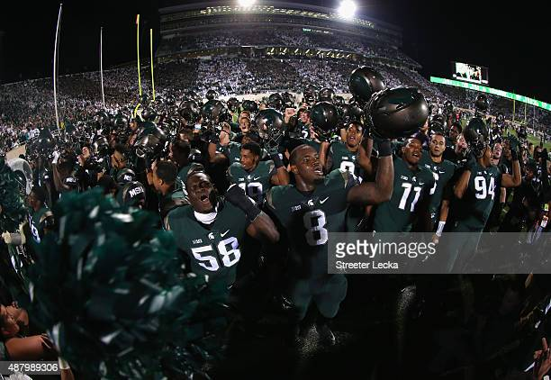 The Michigan State Spartans react after defeating the Oregon Ducks 31-28 at Spartan Stadium on September 12, 2015 in East Lansing, Michigan.