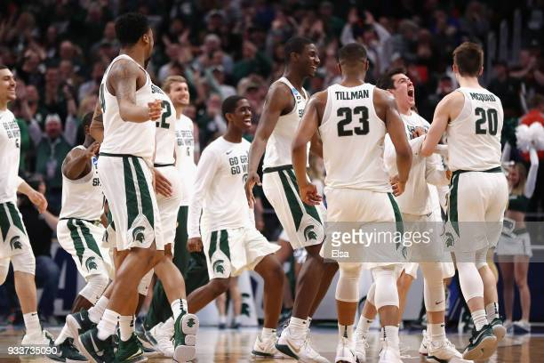 The Michigan State Spartans react during the first half against the Syracuse Orange in the second round of the 2018 NCAA Men's Basketball Tournament...