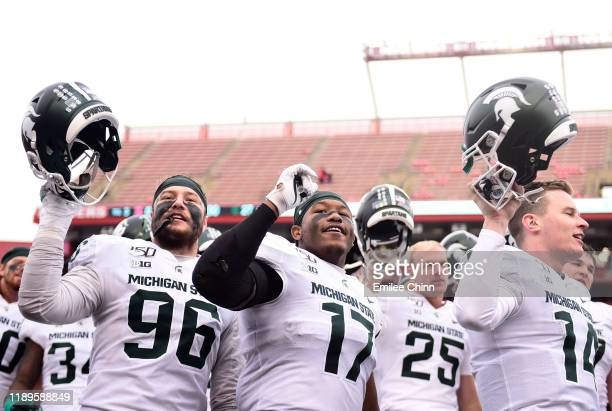The Michigan State Spartans sing their alma mater after their 270 win over the Rutgers Scarlet Knights at SHI Stadium on November 23 2019 in...