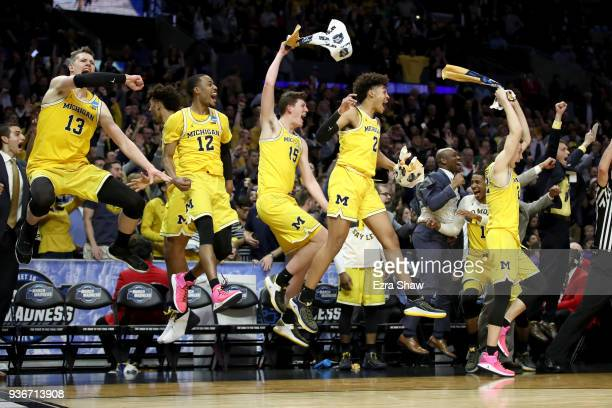 The Michigan Wolverines bench celebrates in the games final minutes against the Texas AM Aggies in the 2018 NCAA Men's Basketball Tournament West...