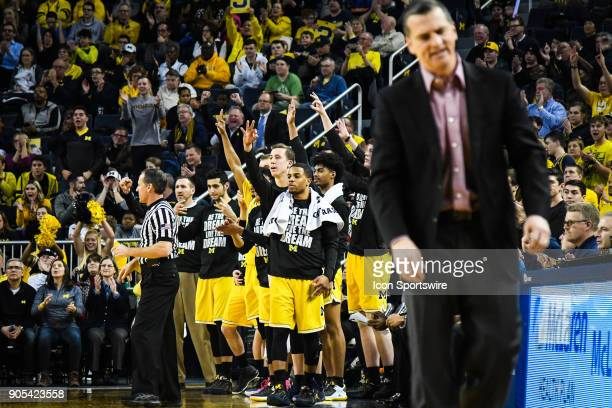 The Michigan Wolverines bench erupts following their 5th consecutive three point basket during the Michigan Wolverines game versus the Maryland...