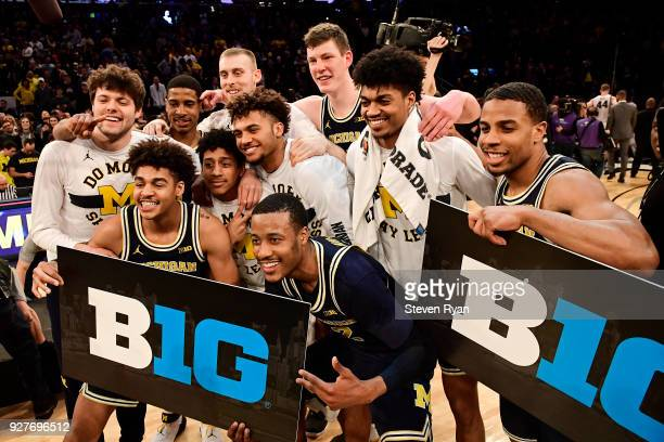 The Michigan Wolverines celebrate a win over the Purdue Boilermakers in the championship game of the Big Ten Basketball Tournament at Madison Square...