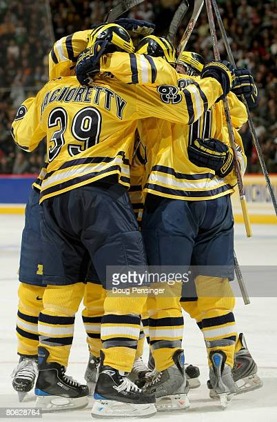 The Michigan Wolverines celebrate after scoring their first goal against the Notre Dame Fighting Irish during their semifinal game at the 2008 NCAA...