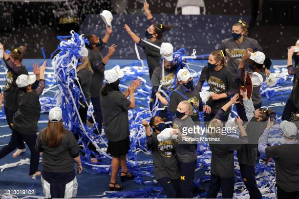 The Michigan Wolverines celebrate after winning the 2021 NCAA Division I Women's Gymnastics Championship at Dickies Arena on April 17, 2021 in Fort...