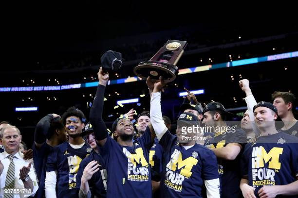 The Michigan Wolverines celebrate with the West Regional trophy after their 5854 victory against the Florida State Seminoles in the 2018 NCAA Men's...