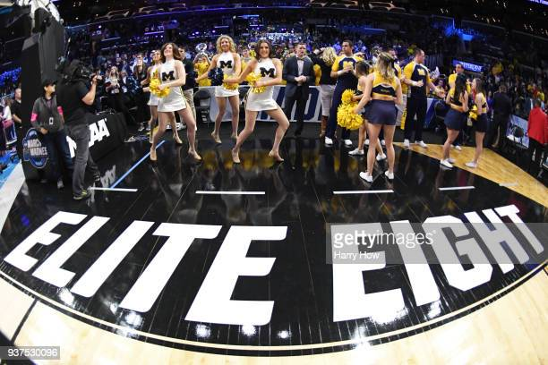 The Michigan Wolverines cheerleaders perform prior to the 2018 NCAA Men's Basketball Tournament West Regional Final between the Michigan Wolverines...