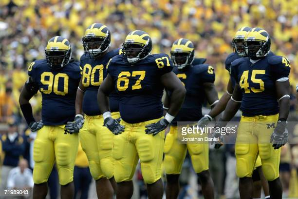 The Michigan Wolverines defensive line stand on the field during the game with the Wisconsin Badgers on September 23 2006 at Michigan Stadium in Ann...
