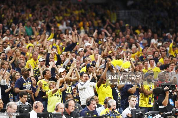The Michigan Wolverines fans cheer on their team against the Villanova Wildcats in the first half during the 2018 NCAA Men's Final Four National...