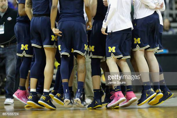 The Michigan Wolverines huddle prior to the 2017 NCAA Men's Basketball Tournament Midwest Regional against the Oregon Ducks at Sprint Center on March...