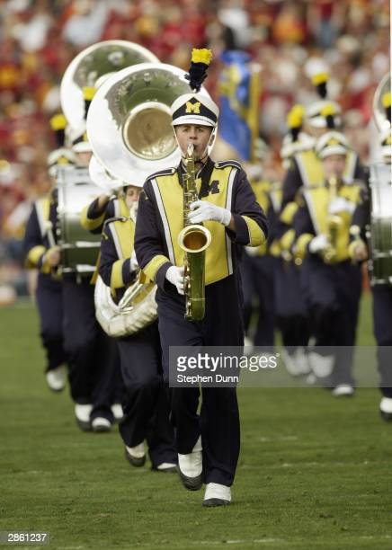 The Michigan Wolverines marching band performs during a break in the 2004 Rose Bowl game against the USC Trojans on January 1 2004 at the Rose Bowl...