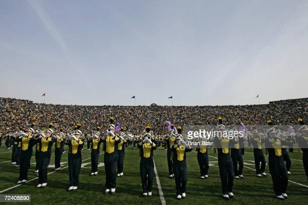 The Michigan Wolverines Marching Band performs during halftime of a game against Ball State on November 4 2006 at Michigan Stadium in Ann Arbor...