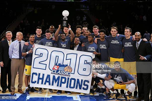 The Michigan Wolverines raise the trophy after defeating the Southern Methodist Mustangs 7654 in the 2K Classic Championship at Madison Square Garden...