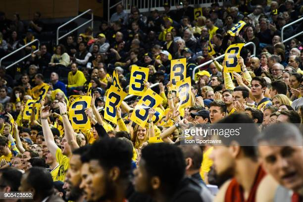 The Michigan Wolverines student section 'Maize Rage' cheers another three point basket during the Michigan Wolverines game versus the Maryland...