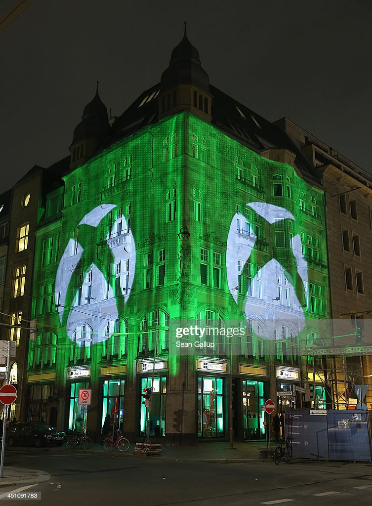 The Microsoft Center stands illuminated during the launch party of the Microsoft Xbox One on November 21, 2013 in Berlin, Germany. Microsoft is launching the new console to compete against the new Sony Playstation 4 ahead of Christmas.