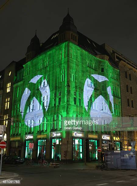 The Microsoft Center stands illuminated during the launch party of the Microsoft Xbox One on November 21 2013 in Berlin Germany Microsoft is...