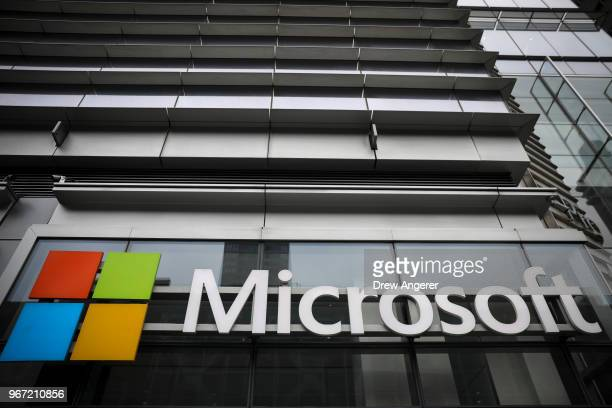 The Microsoft logo is displayed outside the Microsoft Technology Center near Times Square June 4 2018 in New York City Microsoft officially announced...