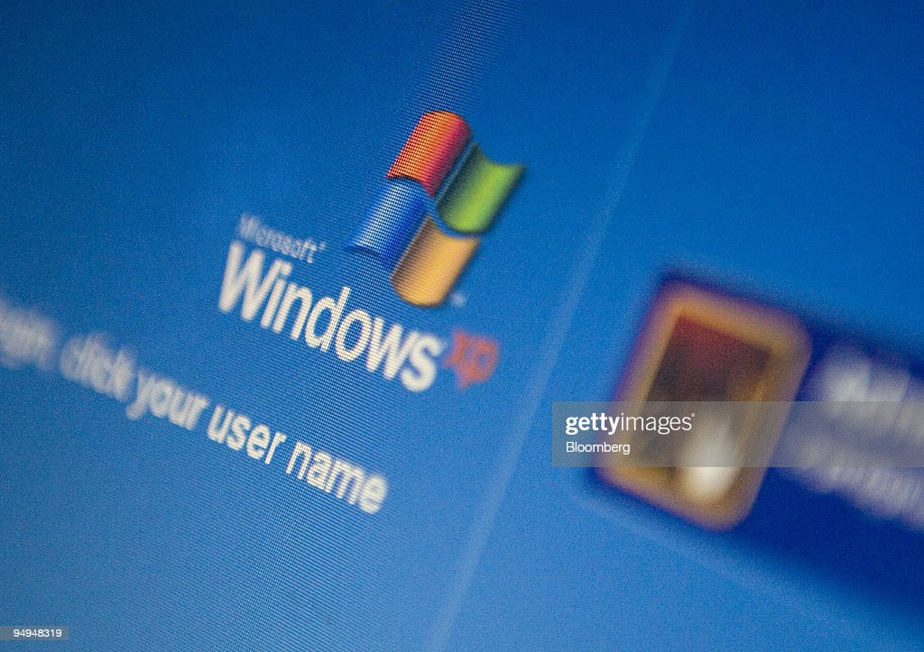The Microsoft Windows XP log-in screen is displayed on a lap : News Photo