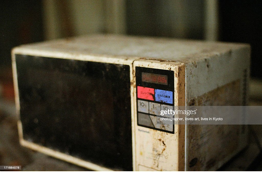 The microwave oven which was old and became dirty : Stock Photo