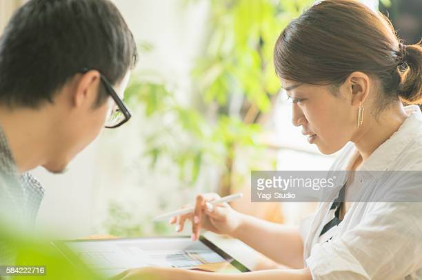 The Mid adult couple looking at a digital tablet