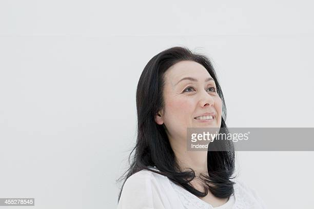 The middle-aged woman of a smiling face