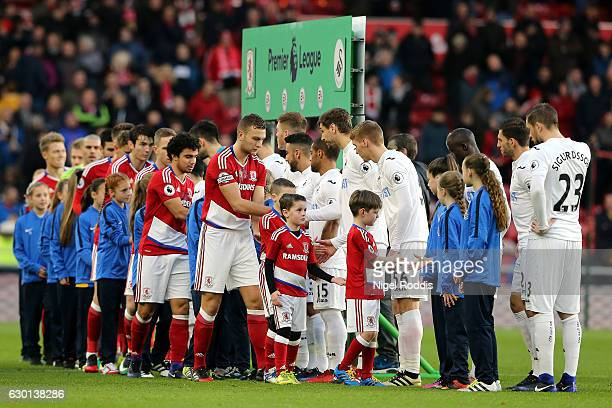 The Middlesbrough and Swansea City players shake hands prior to kick off during the Premier League match between Middlesbrough and Swansea City at...