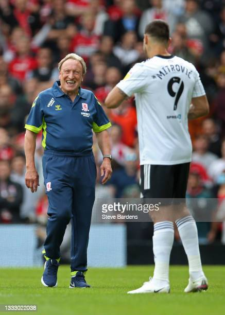 The Middlesbrough Manager, Neil Warnock shares a joke with Aleksandar Mitrovic of Fulham prior to the Sky Bet Championship match between Fulham and...