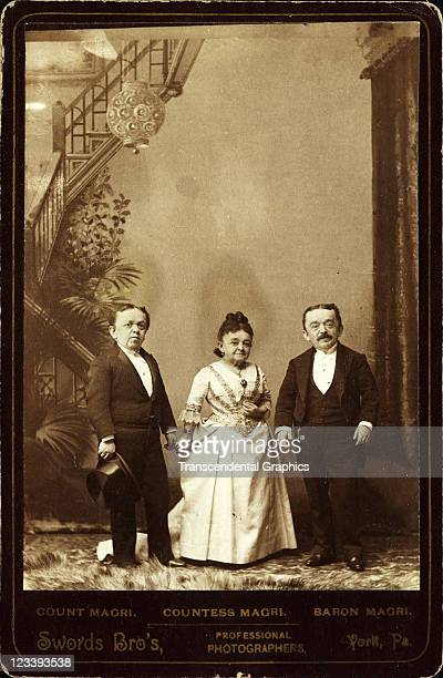 The midget circus and stage performers Count Countess and Baron Magri pose for a studio photograph mid 1880s in York Pennsylvania