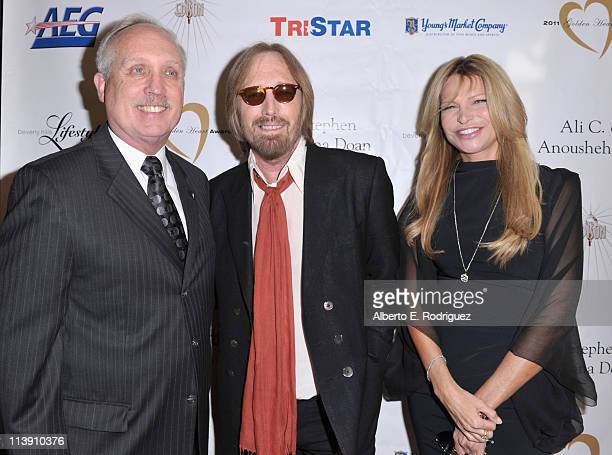 The Midnight Mission's executive director Larry Adamson singer Tom Petty and Dana Petty arrive to The Midnight Mission's 11th Annual Golden Heart...