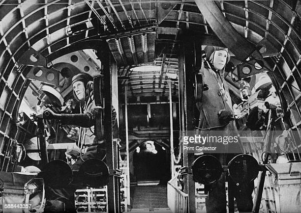 The midship gunners of an RAF flying boat alert at their stations circa 1940 From Coastal Command