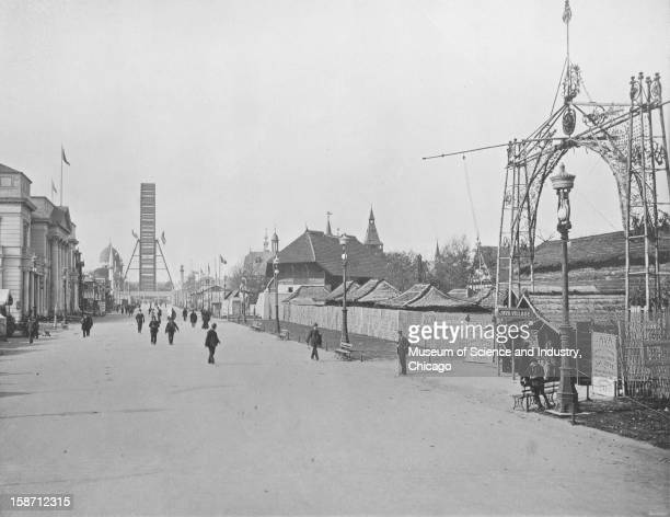 The Midway Plaisance looking west with the Ferris wheel in the background at the World's Columbian Exposition in Chicago Illinois 1893 This image is...