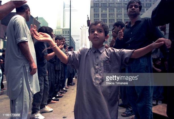 The Midwest Association of Shia Organized Muslims hold an awareness march on July 1 1993 in downtown Chicago Illinois United States