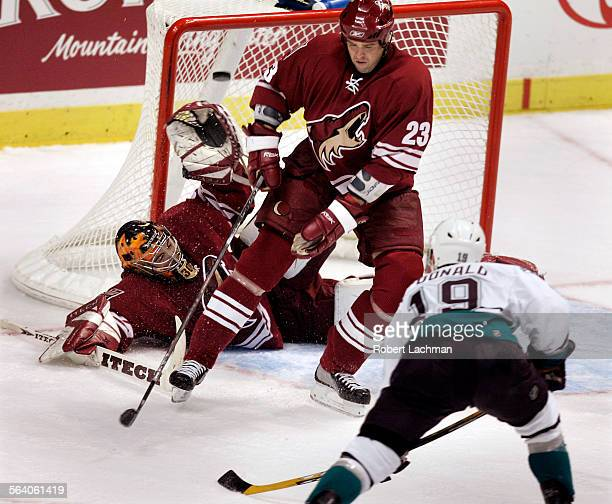 The Mighty Ducks' Andy McDonald puts h]is shot into the upper left corner of the net over the glove of Coyotes' goaltender David LeNeveu and...