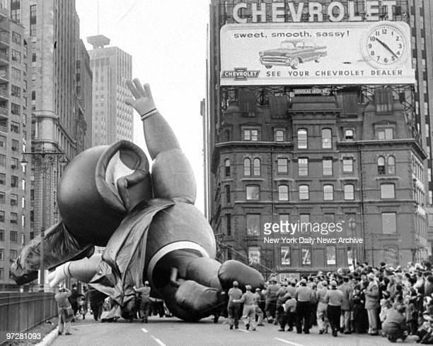 The Mighty Mouse balloon deflating at Columbus Circle during the Macy's Thanksgiving Parade