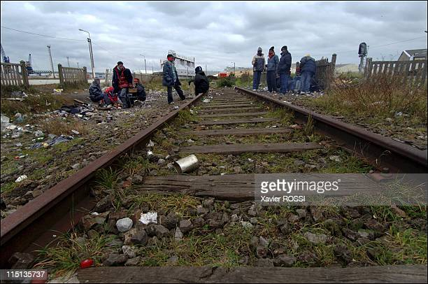 The migrants of Calais to reach Great Britain by all means in Calais France in March 2006 Along a railway track Subsaharian migrants gather around...