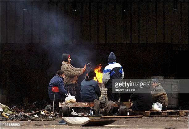 The migrants of Calais to reach Great Britain by all means in Calais France in March 2006 In a disused wharehouse near a lunch distribution point...