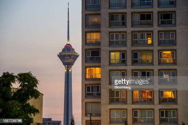 The Milad Tower stands beyond an apartment block at dusk in Tehran Iran on Saturday Nov 3 2018 Irans Supreme Leader Ayatollah Khamenei said US...